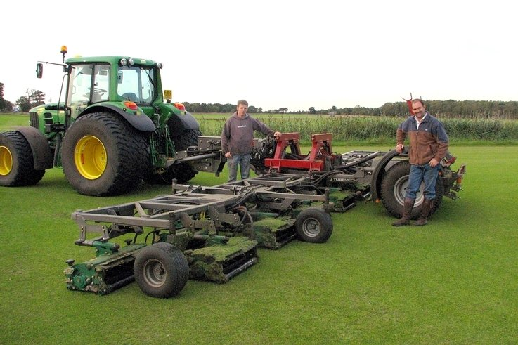 Super-wide mower kept on track by satellite guidance
