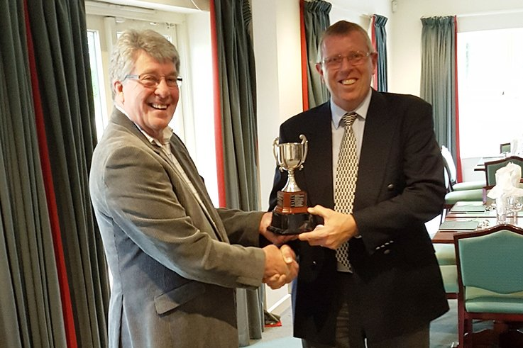 Highspeed's MD David Mears presents the CourseCare Cup to Kevin Pickett GCMA Wessex Captain