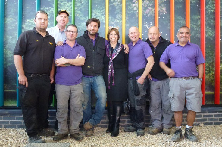 BLEC team Tom Shinkins (Ieft) with Gary Mumby (in cap) and Sue Mumby with TV presenter Nick Knowles and the DIY SOS team at Little Miracles centre in Peterborough