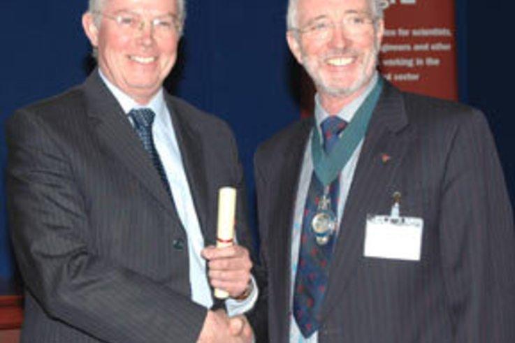Peter Leech receives Award of Merit