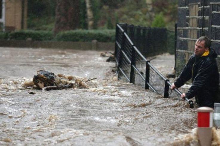 Residents battled against floodwater after the River Calder bursts its banks in Mytholmroyd, West Yorkshire