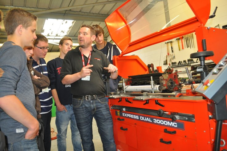 Sports turf students watch Ben Taylor demonstrate a top class cylinder grinder