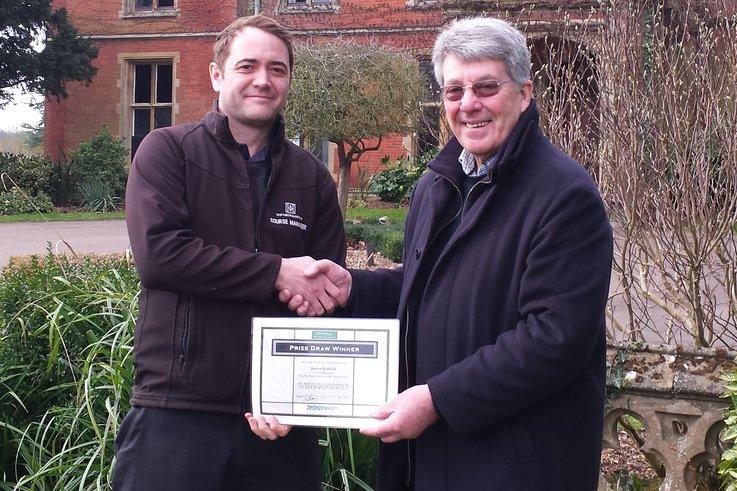 David Mears presents winning certificate to James Bonfield