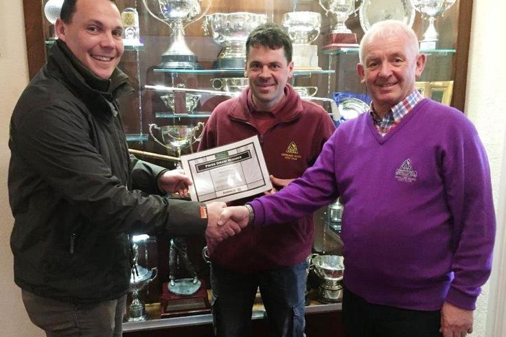 Matthew Mears presents the ClearWater prize certificate at Crosland Heath Golf Club