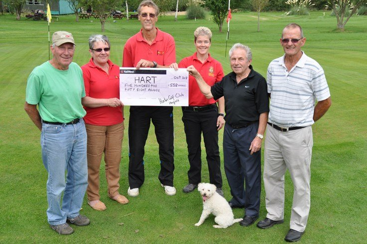 HENFIELD HART cheque from Horton Golf Club. L R Brian Woolven, Anne Pryor, Martin Tooth, Kas Fletcher (with Sasha the HART mascot), Albert Stillwell and Brian Cullen. Pic by Mike Beardall, Oakfield Media DSC 0942