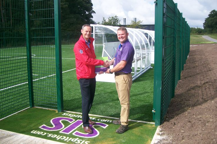 SIS Pitches handing over pitch at St George's Park