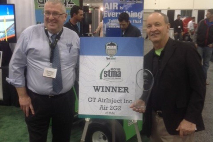 Richard Campey and Air Inject President Glen Black receive the STMA award for the Most Innovative Product