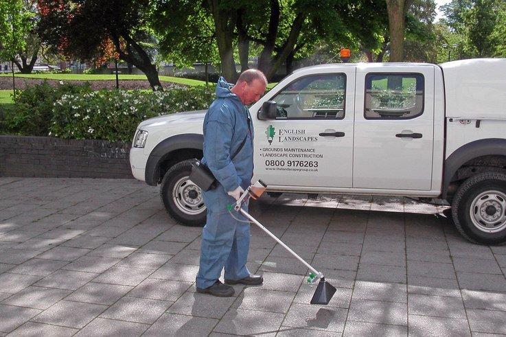 Mankar spraying pavements ALS.JPG