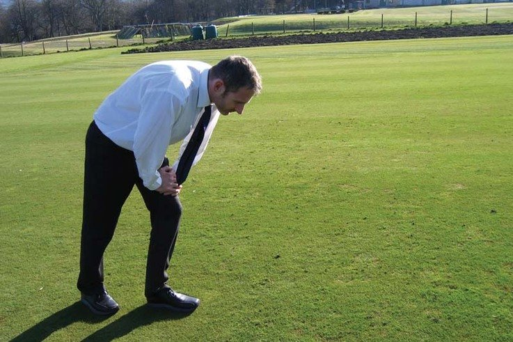 Matthew Palmer of the STRI looks at the Scotts Professional trial areas atBingley, West Yorkshire.jpg
