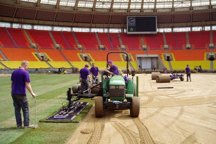 Laying turf in Luzhniki Stadium Moscow with tractor in foreground.jpg