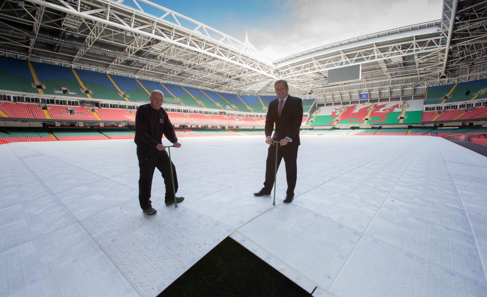 Stadium Manager Mark Williams (right) and Head Groundsman Lee Evans fix the final piece of the new state of the art Millennium Stadium jigsaw