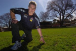 Rod Ward inspects the grass at the Eastern Oval yesterday.