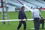 Rugby Park groundsman Russell Thomas with helpers Troy Tatana and Vince Conaghan remove the crossbar from the goal posts at Rugby Park, in Invercargill.