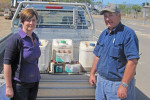 ChemClear National Program Manager Lisa Nixon (right) with sugarcane farmer John Gollogly at the Ingham collection site with some of the chemicals he brought in for disposal.