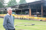 Mudgee Golf Club vice president Brian Insull outside the burned out club house in December 2010.