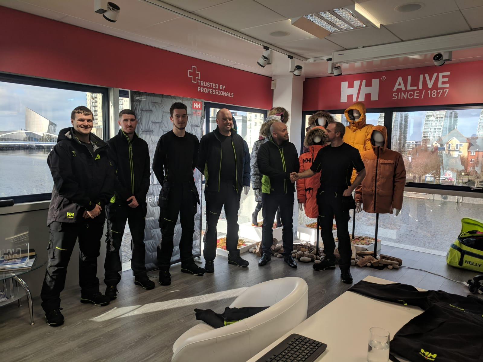Gary Potter Presents Gathurst Golf Club's Greens Team with Their Helly Hansen Workwear.