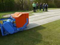 BLEC\'s new GKB Sandfiller in action at Crow Wood Golf Club, Muirhead, Scotland, watched by groundmen and greenkeepers