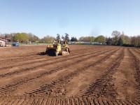 Dozer grading topsoil