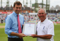 David Sear receiving an award from Mike Atherton.jpg