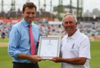 David Sear receiving an award from Mike Atherton.jpg