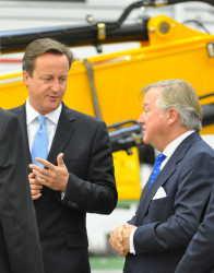 Prime Minister David Cameron and JCB Chairman Sir Anthony Bamford on the Heavy Excavator production line at JCB Brazil