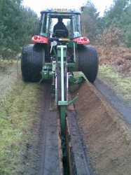 Chain Trencher with short conveyor.jpg