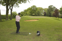 Paul Foston practises on one of his Huxley Golf all weather