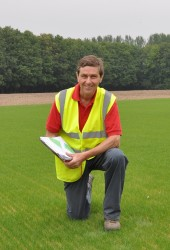 Speedcut contracts manager Kevin Smith on pitch one at Kings Hill, Kent, two weeks after seeding   Copy