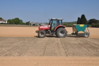 The scale of the Kidbrooke Playing Fields job can be seen in this shot of Speedcut applying sand prior to seeding