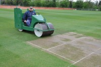 Damian Meech rolls a new wicket the day before a match at the new King\'s CollegeSchool cricket square.JPG