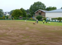 Saundersfoot Getting the topdressing down is a strictly manual job