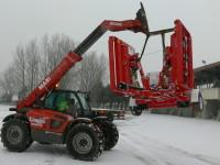 Unloading for demo in the snow.JPG