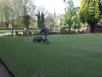 Kevin applies liquid feed & wetting agent