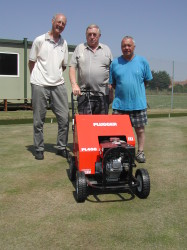 Treasurer Fred Jervis, chairman Brian Ash and greenkeeper Richard Musson with the Plugger PL400 at Helpringham Bowls Club, Lincolnshire.JPG