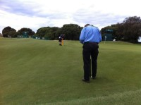 Presidents cup Day 2: agronomists measuring surface firmness