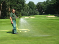 2. Hand watering 6th green
