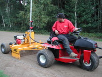 Speedcut BLEC laser grader and Toro Sandpro in action at Foxhills. Front view.JPG