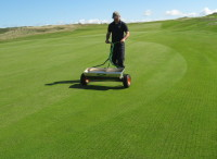IMG_7105  Drop seeder used for Fescue overseed following solid tining  Royal Porthcawl.jpg