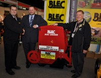 BLEC\'s Tom Shinkins (left) at BTME with Cleethorpes Golf Club course manager Rob Welford and chairman of greens John Stanley and their newly purchased BLEC close space disc seeder DSC 0386