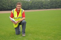Kevin Smith, Speedcut contracts manager, on the first of five pitches at Kings Hill, Kent, two weeks after seeding