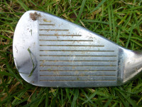 Plate 2 Golf club with soil and sand in grooves