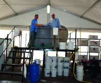 Gavin Lishman with Paul Burgess, Head Groundsman at Real Madrid Football Club, and their 2000 litre Compost Tea System