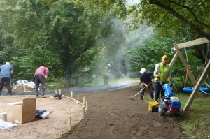 BLEC md Gary Mumby and the DIY SOS team preparing paths through the woodland at Little Miracles centre in Peterborough