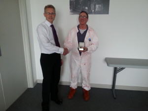 Kevin receiving his award from COO Peter Wood