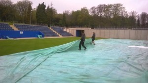 Figure 3- While pulling covers with limited staff numbers is hard work, it helps to facilitate our 'little and often' approach to drying down our courts.