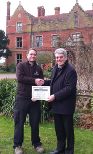 David Mears presents winning certificate to James Bonfield
