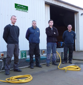 The greenkeeping team at Holme Hall on the ClearWater system washpad and all you see are hoses and turret tops!