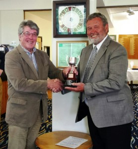Highspeed's MD David Mears presents the CourseCare Cup to Graham Fisher