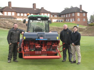 Ian Morrison, Course Manager at The Berkshire GC (second right) takes delivery of his new Wiedenmann Terra Spike XP 160 from Dave Gray, Area Sales Manager at T H White Reading. With them is Jim Simpson, left, who has recently joined the Ascot club as Mechanic from Bearwood Lakes GC.