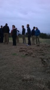 Inspecting the hog damage